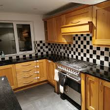 price of painting kitchen cabinets grey spray painted kitchen cabinets totally transform this