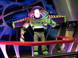 wdwthemeparks com buzz lightyear s space ranger spin a large view master toy can be seen next to buzz lightyear displaying a variety of space related images buzz lightyear s narration is the following 1