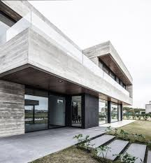 textured front facade modern box home a modern concrete house designed by remy architects