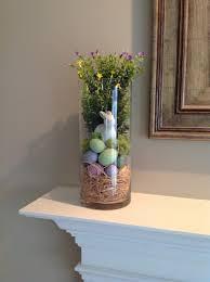 hurricane glass vase filler for spring and easter on the mantel