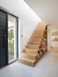 funky bookshelves storage space under stairs for small space
