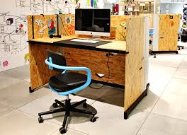 vitra workspace vitra office showroom and experimental laboratory konstantin grcic s osb hack table for vitra created for offices