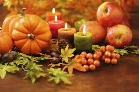 simple thanksgiving centerpiece of mini pumpkins candles apples