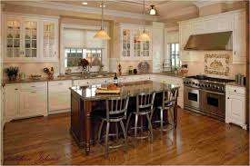 caramel kitchen cabinets with dark floors cream kitchen with dark