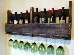 contemporary wall mounted metal wine rack installed in the black