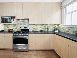 interior glass tile backsplash white kitchen cabinets with