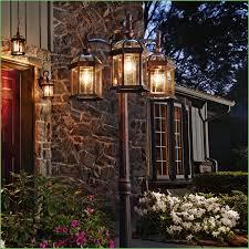lighting post light illuminating an entryway outdoor lamp post