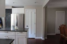 new apartment sneak peak living room dining room white trim