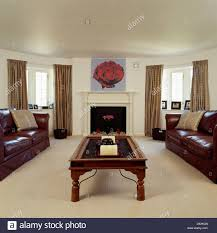 Leather And Wood Coffee Table Brown Leather Sofa And Wood Coffee Table In Living Room