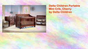 Delta Mini Crib Mattress by Delta Children Portable Mini Crib Cherry By Delta Youtube