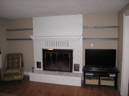 classy white brick exposed wall painted fireplace added floating