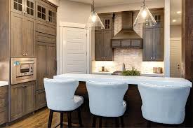white kitchen countertops with brown cabinets brown stained kitchen cabinets with white quartz countertop