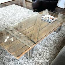 repurposed table top ideas repurposed table top ideas barn door into a coffee table glass top