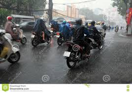 raincoat for bike riders heavy rain rainy season at ho chi minh city editorial image