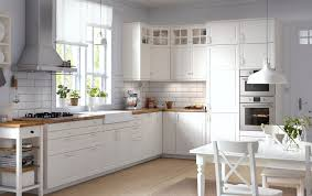 ikea kitchen modernkitchen ikea modern n 455695046 kitchen ideas traditional kitchen with white cabinets wood worktops glass doors and integrated appliances ikea modern a 1864790836