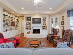 living room designed with a fireplace and built in shelves for