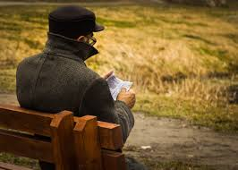 old man reading book park bench free stock photo negativespace
