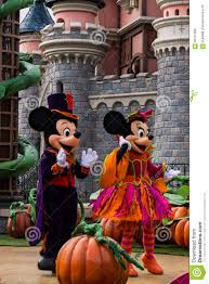 mickey mouse and minnie mouse during halloween celebrations at