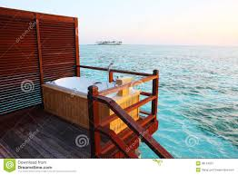 outdoor bathtub in sunset maldives royalty free stock photography