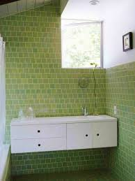 contemporary bathroom with green wall and tiles white tub curtain