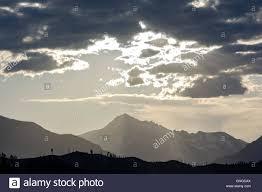 the sun breaks through the clouds as a