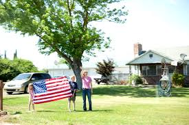 A American Flag Pictures Free Public Domain Image Kids Holding An American Flag In A Yard