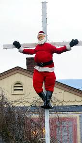 man protests commercialized christmas by crucifying santa