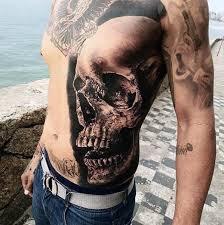skull and roses ink cyclopedia 59 fabulous skull tattoos for rib