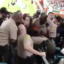 miami fan slaps officer shocking footage of american football fan being punched by police