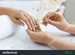 cuticle remover closeup woman hands receiving stock photo