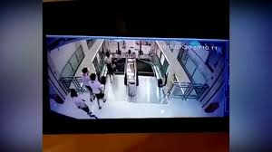 crushed by escalator mother saves her child as she is crushed by rolling escalator