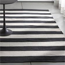 olin black striped cotton dhurrie rug crate and barrel