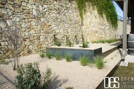 Pea Gravel Concrete Patio by Exterior Design Stone Wall With White Gravel And Concrete Plants