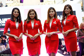 airasia uniform woman disgusted by air asia flight crew uniforms daily mail online