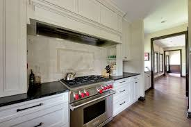 kitchen cabinets off white cabinets with dark backsplash pink