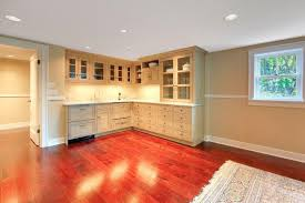 basement with cherry red wood floor and small kitchen homeyou