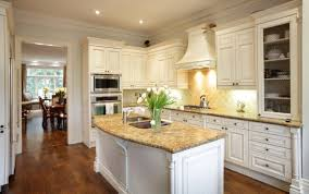 Kitchen White Cabinets With Granite Countertops And Dark Floors - Granite on white kitchen cabinets
