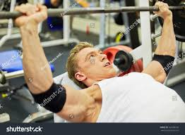 young athlete man does bench press stock photo 161383196