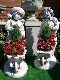 boy and planter garden ornament statue berkshire