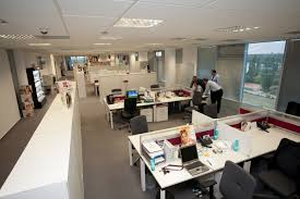 the open space is a classic open plan office where a large floor