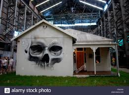 skull painted on a house within an industrial building at an stock