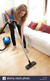 Vacuuming Portrait Of A Young Woman Vacuuming Stock Photo Royalty Free
