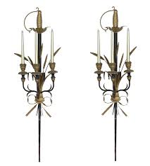 Gold Wall Sconces For Candles Pair Of Italian Gold And Black Sword Wall Sconces For Sale At 1stdibs