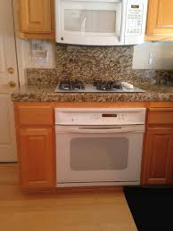 white kitchen cabinets orange walls maple cabinetry turned yellow orange what color walls