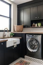 best place to buy cabinets for laundry room rich black cabinetry in our summit creek project laundry