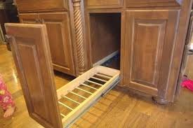trash can attached to cabinet door recycled cabinet doors reclaimed kitchen cabinets interesting idea