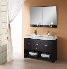 black wooden bathroom vanity with double white sink on ceramics