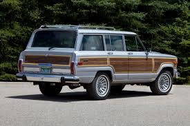 old jeep grand cherokee jeep is bringing back the wagoneer and grand wagoneer as luxury