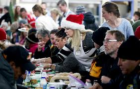 help with christmas president uchtdorf helps serve homeless a christmas day dinner