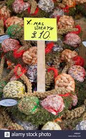 market stall display of festive christmas wreath craft materials
